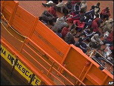 Migrants await instructions after arriving in Spain, June 18 2008