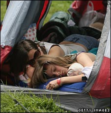 Women sleep in tent at Isle of Wight festival