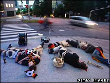 German fans sleep on the footpath during Euro 2008