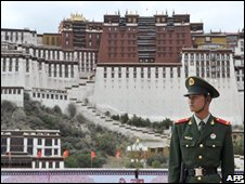 A police officer stands guard in Lhasa, Tibet, 20/06