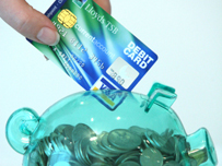 A Lloyds debit card and piggybank