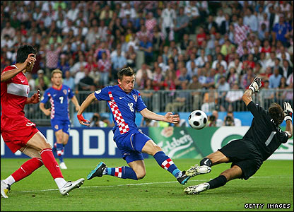 Croatia's Ivica Olic thumps Luka Modric's cross against the crossbar