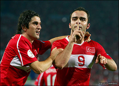 Turkey's Semih Senturk celebrates scoring the equaliser with the last kick of the game