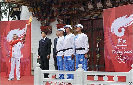 An Olympic torchbearer prepares to set out on a procession through Lhasa