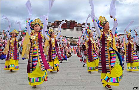 Tibetan performers dance in front of the Potala Palace in Lhasa