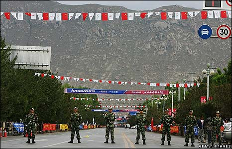 Police officers close a street ahead of the torch procession through Lhasa