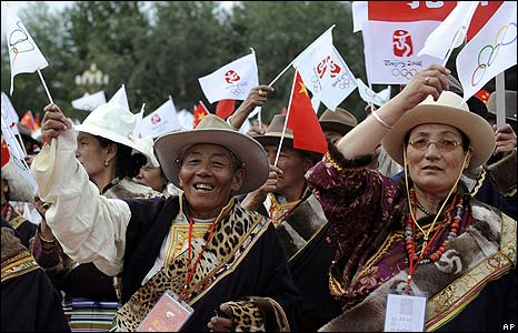 Tibetan people wave Beijing Olympics flags to welcome the torch in Lhasa