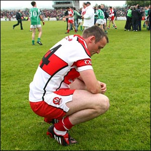 Derry star Paddy Bradley takes a moment to take in the semi-final defeat