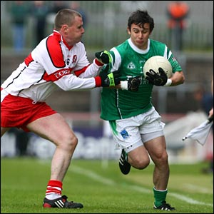 Derry's Niall McCusker challenges Shane McCabe at Healy Park