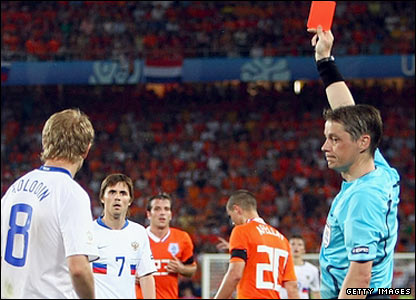Denis Kolodin is shown the red card