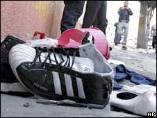 Victims' shoes outside the News Divine nightclub