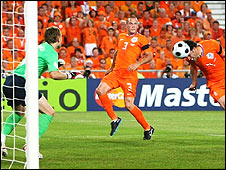 Ruud van Nistelrooy (right) heads in Netherlands' late equaliser