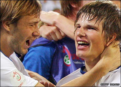 Russia goalscorer Andrei Arshavin (right) celebrates with Dmitry Sychev
