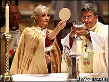 Kay Goldsworthy (L) and the Archbishop of Perth, Roger Herft, at the consecration service for her ordination as Australia's first Anglican bishop