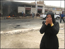 Shocked woman in aftermath of Baquba bombing