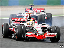 Lewis Hamilton locks a wheel as he heads McLaren team-mate Heikki Kovalainen early in the French Grand Prix