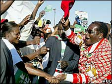 President Robert Mugabe (right) greets his supporters in Bulawayo. File photo