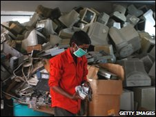 A worker dismantles old computers and electronics at E-Parisara, an electronic waste recycling factory in Dobbspet, India, April 11 2008