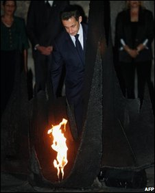 French President Nicolas Sarkozy lights the eternal flame at the Hall of Remembrance at the Yad Vashem Holocaust memorial museum, Israel, 23/06/08