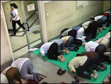 Muslim men praying in an Egyptian workplace