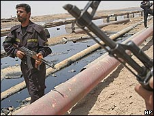 Soldiers guard oil pipelines near Basra in Iraq