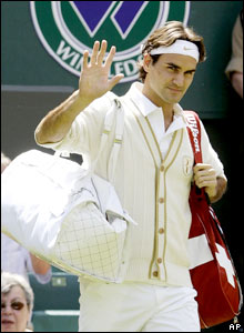 Defending champion Roger Federer walks out on Centre Court