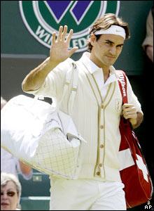 Defending champion Roger Federer walks out on Centre Court