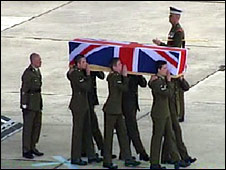 One of the coffins is carried at RAF Lyneham