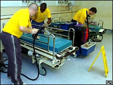 Staff cleaning hospital ward