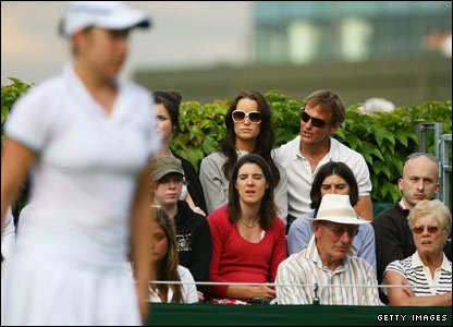 Teddy Sheringham watches Mel South's match against Alona Bondarenko on Court 18
