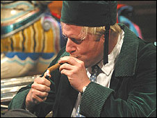 Boris Johnson lighting a cigar on BBC's Room 101