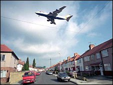 Aeroplane flying low over houses on approach to Heathrow airport.