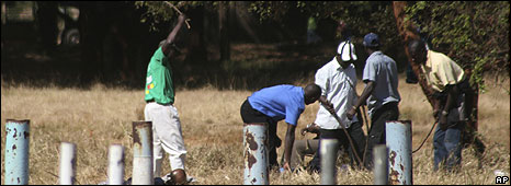 Members of the ruling party Zanu PF militia, beat unidentified people at the venue of the proposed Movement for Democratic Change (MDC) party rally in Harare, Sunday, June 22, 2008.