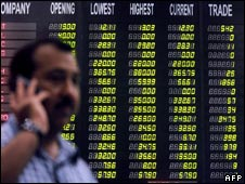 A Pakistani trader monitors shares' movements at the Karachi Stock Exchange