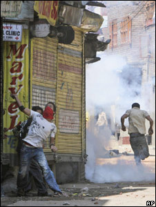 A Kashmiri protester throws stones at policemen during a protest in Srinagar on June 24, 2008.
