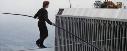 Philippe Petit walks the wire suspended between New York's twin towers