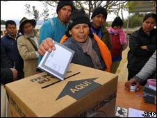 A woman vote's in Sunday's autonomy referendum in Tarija
