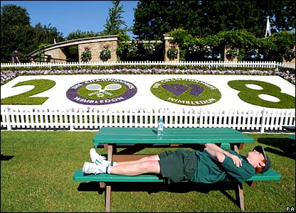 A member of the Wimbledon ground staff