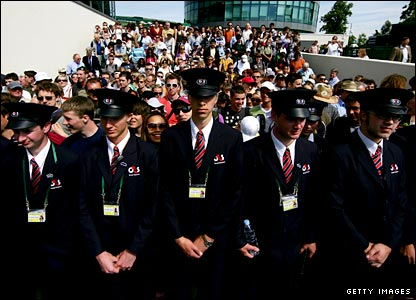 Wimbledon security guards prepare to let the crowd in