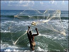 Fisherman casting a net (Image: AP)