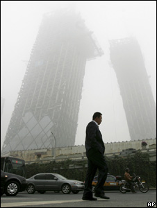 Man walking through smog (Image: AP)