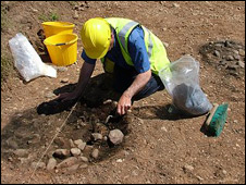 An archaeologist digging at the quarry