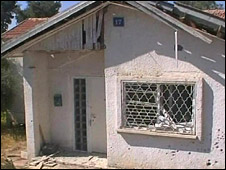 A house is damaged in the Israeli town of Sderot after a rocket lands in its garden, 24 June 2008