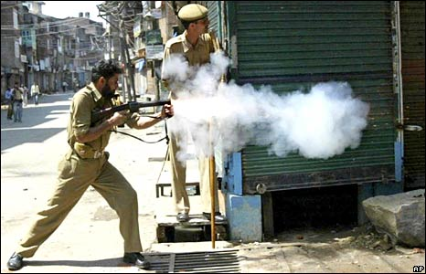 Police fire tear gas to disperse protesters in Srinagar, Indian-administered Kashmir, on 24 June 2008