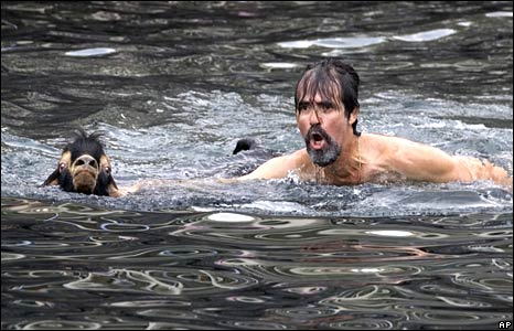 A shepherd bathes his goat in the sea during a purification ritual at the festival of St John in Puerto de la Cruz, Tenerife, Spain, on 24 June 2008
