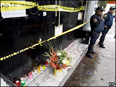 Flowers and candles left outside Mexico City nightclub where stampede happened - 24/6/2008
