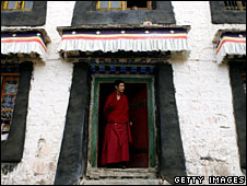 A monk stands in a doorway at Sera monastery in Lhasa on 22 June 2008