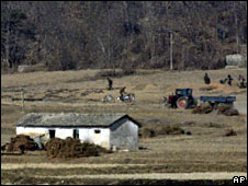 North Korean farmers, close to Panmunjom in the demilitarized zone