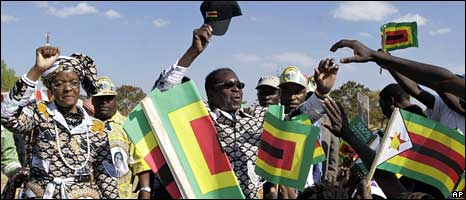 Robert Mugabe and his supporters