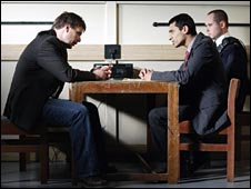 Scene from a BBC drama featuring police interview room